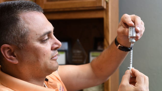 Frank Vacco, 40, self-administers immunotherapy shots every other day to help treat his allergies. Allergy season is in full swing in the Twin Lakes Area.