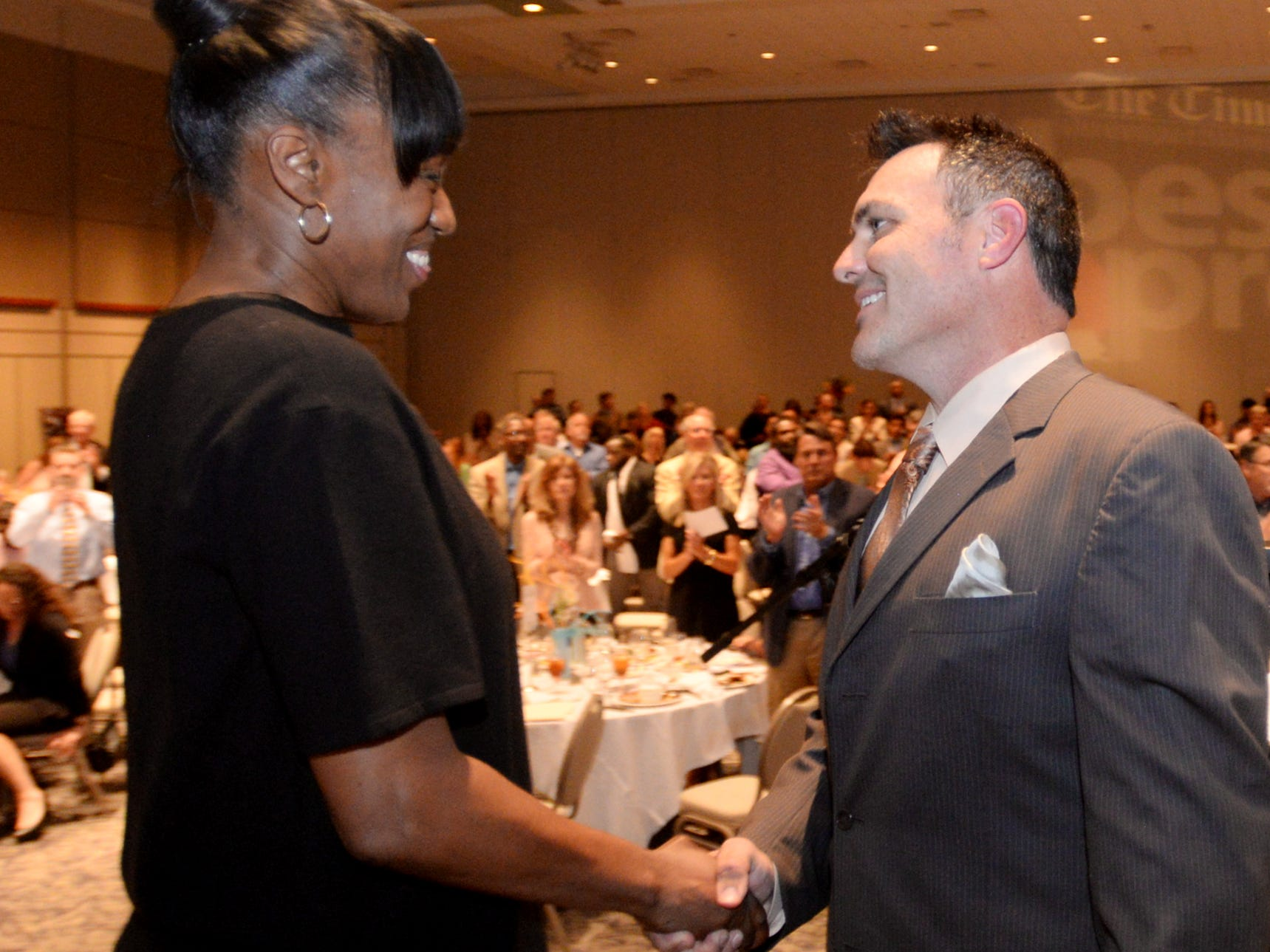 The Times Sports Editor Roy Lang III shakes hands withJackie Joyner-Kersee as he introduces her as the key speaker at the inaugural Best of Northwest Louisiana Preps banquet Tuesday evening at the Shreveport Convention Center.