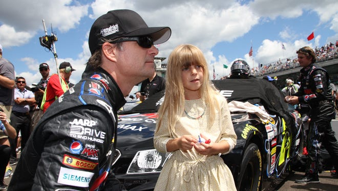 FILE - Jeff Gordon and daughter, Ella, prior to the start of the Brickyard 400, July 28, 2013.