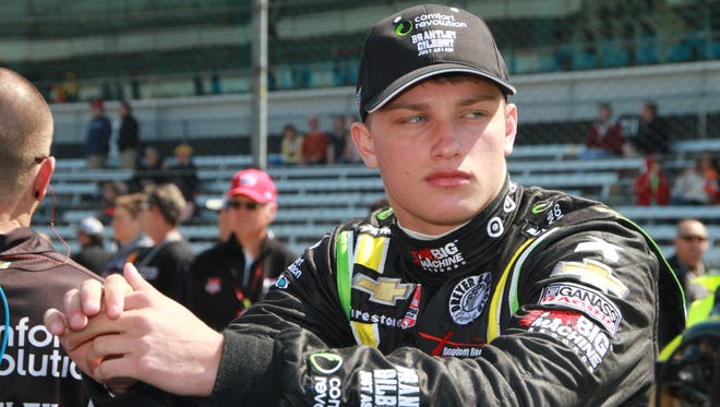 Rookie Sage Karam in the pit area prior to qualifying at the Indianapolis Motor Speedway, May 18, 2014.