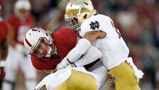Max Redfield (10) and Devin Butler (12) of the Notre Dame Fighting Irish were arrested in separate incidents.