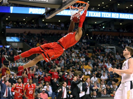 Texas Tech's Justin Gray dunks against Purdue during the second half of an NCAA men's college basketball tournament regional semifinal Friday, March 23, 2018, in Boston. (AP Photo/Mary Schwalm)