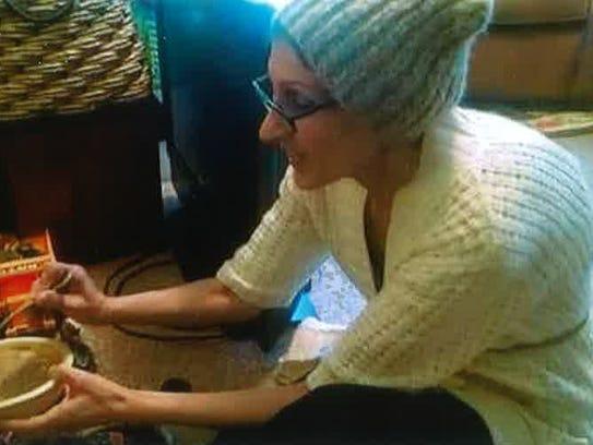Antoinette Quain feeds her granddaughter, Alison Rossi.