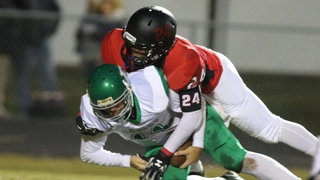 Hillcrest's Raymond Griffen (24) takes down Easley's Dalton Black (11) for a loss.