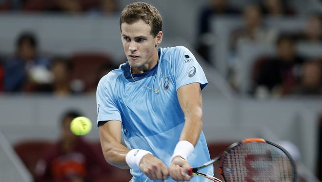 Vasek Pospisil of Canada is seen here returning a shot against Rafael Nadal during the China Open. On Friday, Pospisil beat German qualifier Daniel Brands to set up a Valencia Open semifinal against Joao Sousa of Portugal.