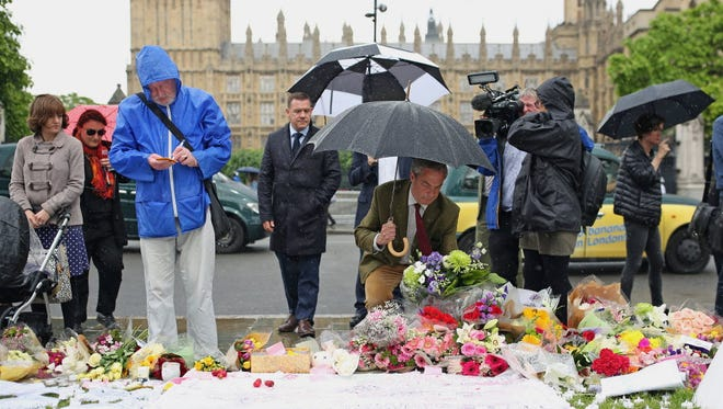 UKIP leader Nigel Farage arrives to leave a tribute to Jo Cox on Parliament Square in London on June 17.