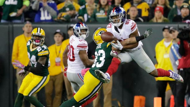 Green Bay Packers safety Micah Hyde breaks up a pass intended for New York Giants receiver Sterling Shepard at Lambeau Field.