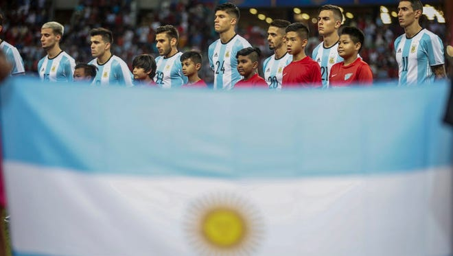 Argentina national soccer team players pictured behind their flag at the start of an international friendly soccer match between Singapore and Argentina at the National Stadium in Singapore.