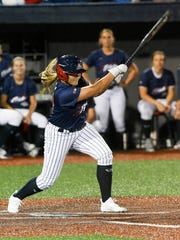 Lauren Chamberlain gets a hit during Wednesday's game against Chicago.