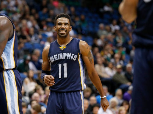 FILE - In this Nov. 15, 2015, file photo, Memphis Grizzlies guard Mike Conley (11) smiles during the second half of an NBA basketball game against the Minnesota Timberwolves in Minneapolis. The NBA announced Saturday, April 23, 2016, that Conley is the winner of the Joe Dumars Trophy for sportsmanship. The annual award for ethical behavior and fair play is named for former Detroit Pistons guard and Hall of Famer Joe Dumars.   (AP Photo/Ann Heisenfelt, File)