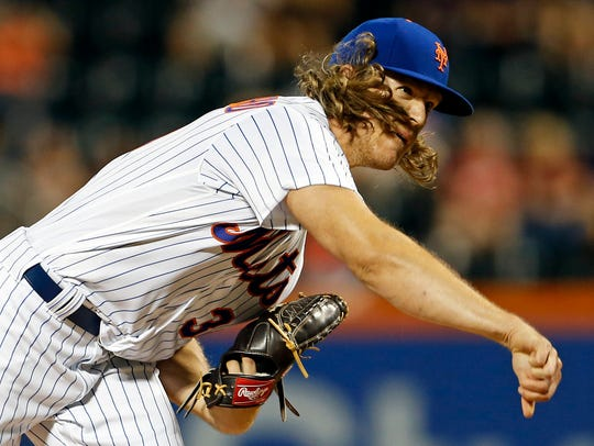 New York Mets pitcher Noah Syndergaard watches a pitch