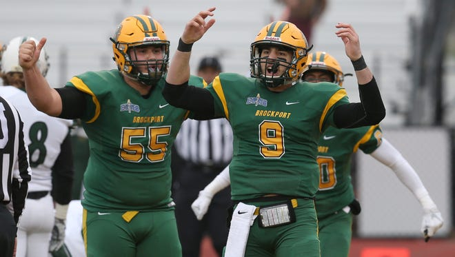 Brockport's starting quarterback Joe Germinerio, 9, celebrates with teammate Mark Sanchez after his rushing touchdown in the first quarter giving Brockport a 6-0 lead in the team's victory over Plymouth State.