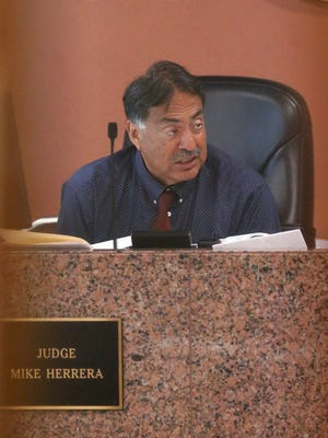 Mike Herrera is the 383rd District Court judge.