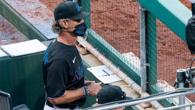 Miami Marlins' manager Don Mattingly looks out from the dugout during the eighth inning of a game against the Philadelphia Phillies, Saturday, July 25, 2020, in Philadelphia.