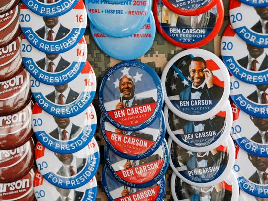 Campaign buttons for Ben Carson are displayed before