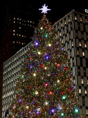 With 19,000 lights, the tree is fully lit up on Friday evening, Nov. 18, 2016, in Campus Martius Park in downtown Detroit.