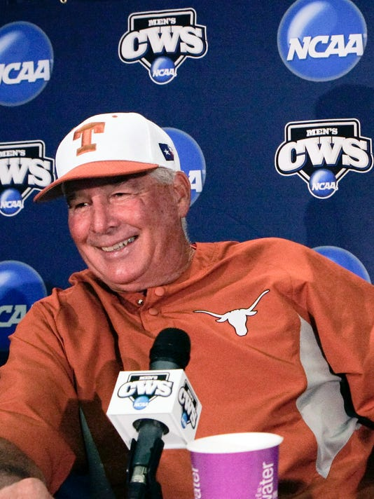 FILE - In this June 12, 2009, file photo, Texas coach Augie Garrido smiles before the baseball coaches traditional news conference ahead of the NCAA College World Series at Rosenblatt Stadium in Omaha, Neb. Garrido, who won three national baseball championships at Cal State Fullerton and two more at Texas, has died, the University of Texas announced Thursday, March 15, 2018. He was 79. (AP Photo/Nati Harnik, File)