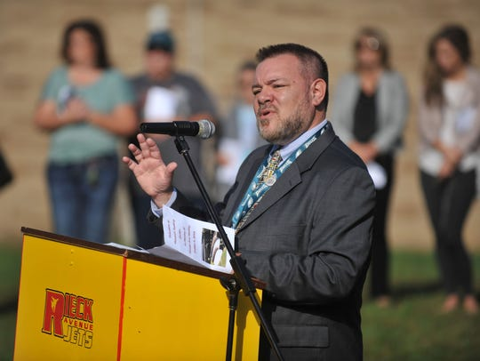 Principal Brian Robinson talks as a memorial reading