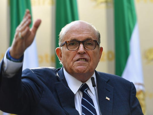 """Rudy Giuliani, Former Mayor of New York City speaks to the Organization of Iranian American Communities during their march to urge """"recognition of the Iranian people's right for regime change,"""" outside the United Nations Headquarters in New York on September 24, 2019. - They urged recognition of the Iranian people's right for regime change and declared their support for the leader of democratic opposition, Maryam Rajavi. (Angela Weiss/AFP/Getty Images/TNS)"""