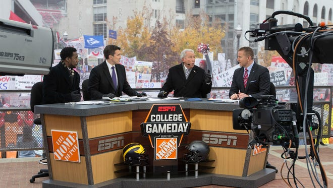 Nov 26, 2016; Columbus, OH, USA; ESPN College Gameday hosts from left Desmond Howard and Rece Davis and Lee Corso and Kirk Herbstreit discuss the days matchups on their set outside Ohio Stadium before the game between the Ohio State Buckeyes and Michigan Wolverines. Ohio State won the game 30-27 in double overtime. Mandatory Credit: Greg Bartram-USA TODAY Sports