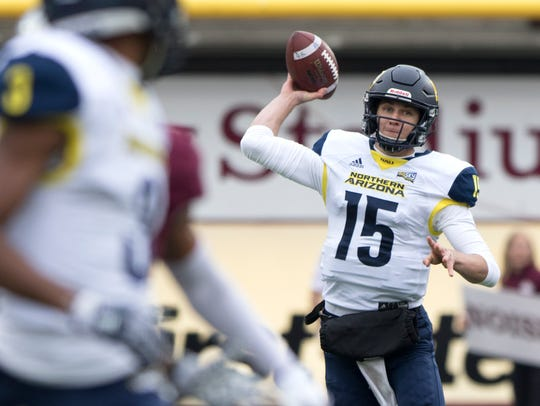 Northern Arizona quarterback Case Cookus (15) throws