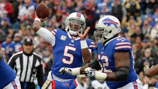 Buffalo Bills quarterback Tyrod Taylor (5) throws a pass during the first half of an NFL football game against the New Orleans Saints Sunday, Nov. 12, 2017, in Orchard Park, N.Y. (AP Photo/Adrian Kraus)