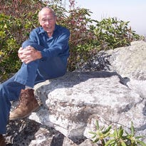 Howard McDonald, seen here in 2012, takes inventory of posts and trail markers along the Appalachian Trail at Max Patch as he works to maintain the trail. McDonald volunteered for 22 years building and maintaining trails with the Carolina Mountain Club before he died suddenly in September.