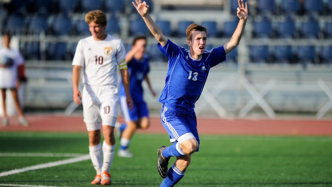Memorial's Andrew Cross (13) celebrates a goal past Chesterton's Tyler Schroeder (10) during the Class 2A state championship at Carroll Stadium in Indianapolis, Saturday, Oct. 29, 2016. Memorial beat Chesterton 2-1.