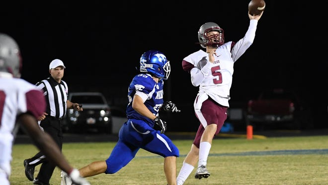Jackson Williamson fires a pass against Woodmont Friday in Piedmont.