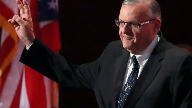 In this July 21, 2016, file photo, Sheriff Joe Arpaio of Arizona walks on the stage to speak during the final day of the Republican National Convention in Cleveland. The outgoing sheriff of metro Phoenix said he was saddened by his defeat after 24 years in office, but expressed no regrets about launching dozens of immigration patrols that made him a national political figure but ultimately led to downfall and a criminal case against him. Sheriff Joe Arpaio said Friday, Nov. 11, 2016, that he has been humbled by calls from supporters who bemoaned his loss Tuesday to Democrat Paul Penzone.
