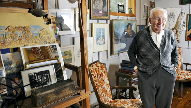 Artist Bela Petheo is shown with his paintings at his studio in October 2014. The legacy of Petheo, a local artist with a national and international following, is being honored with an exhibit of his work at the Paramount Center for the Arts.