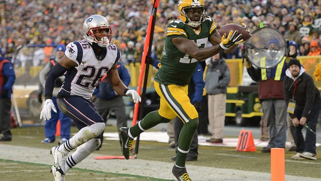 Green Bay Packers receiver Davante Adams (17) makes a catch against the New England Patriots during Sunday's game at Lambeau Field. Adams was ruled out of bounds on the play.