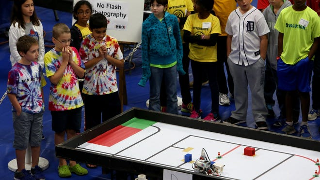 Parents, kids and competitors watch the action as a programmable robot follows the course on a mission to build a simulated rocket and rescue three Lego people during the World Robot Olympiad USA 2014 National Championship at the Don Ridler Field House on the campus of Lawrence Technological University in Southfield, Michigan on Saturday September 27, 2014. Fifteen different school from Michigan, California and Illinois competed in the championship.