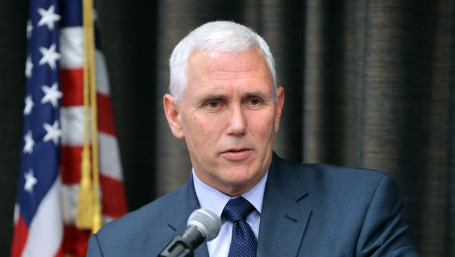 Indiana Gov. Mike Pence speaks to the Federalist Society in Indianapolis on June 13.