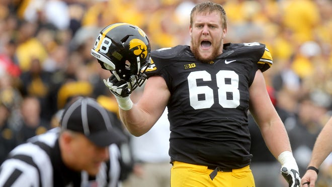 When Brandon Scherff was a redshirt freshman in 2011, he made three starts at left guard, playing between skilled linemen who today are chasing pro dreams. Their assistance 'helped me a lot,' the preseason all-America tackle says.