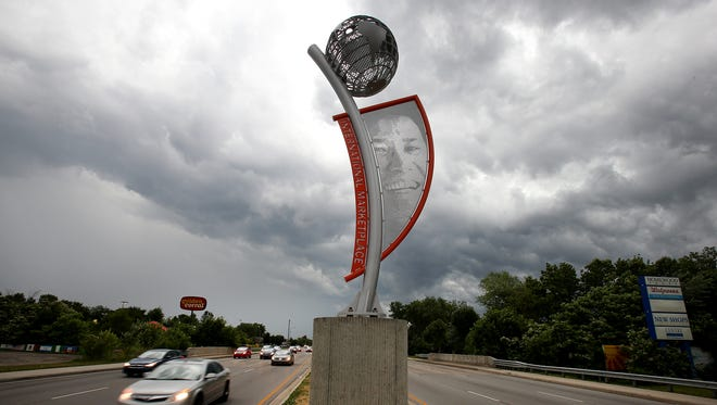 A new sculpture was unveiled June 18, 2014, at West 38th Street and High School Road on the Westside. The silver gateway structure, which features a globe and image of a resident, reflects a new marketing effort to rebrand the Lafayette Square area as the International Marketplace.