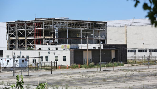 While crews are dismantling the former GM Stamping Plant, concert promoter Dave Lucas plans to salvage and renovate one of the site's craneways as part of a new concert venue.