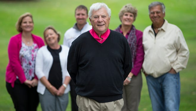 Bill Roberts, 70, who suffered a heart attack in July at the Golf Club of Indiana course in Lebanon, Ind., stands with the people who saved him at a reunion on the course on Oct. 3, 2014.