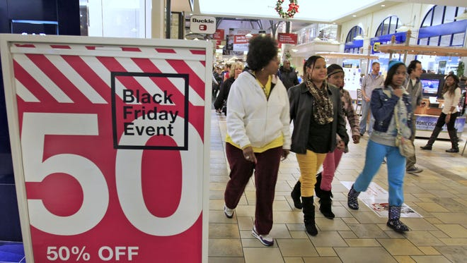 Many stores offered special deals at Castleton Mall, Thursday, November 28, 2013, including, as seen here, Gap Kids.  Many stores at the mall opened at 8pm this year, some a midnight.  Last year the mall opened at midnight to start the holiday's Black Friday shopping season.