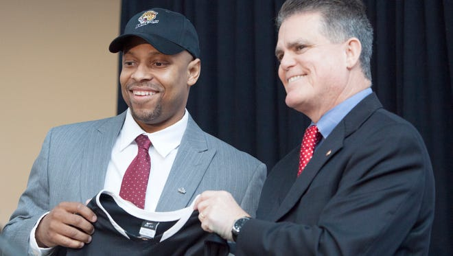 Jason Gardner poses for photographs after he is officially announced as the head basketball coach for IUPUI, April 2, 2014.