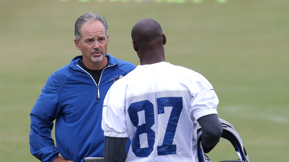 Indianapolis Colts head coach Chuck Pagano talks with WR Reggie Wayne during their morning practice at training camp Monday July 28, 2014, morning in Anderson IN. Matt Kryger / The Star