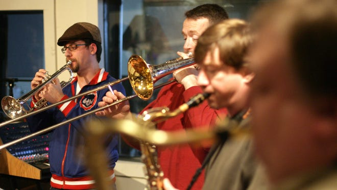 "(left to right) Justin Mann, Greg Young, Jim Pickering and Saul Lubaroff play horns during a rehearsal for the Steely Dan tribute band, ""The Fez,"" Sunday, April 17, 2011, at the Minstrel Recording Studio, in Iowa City, Iowa."