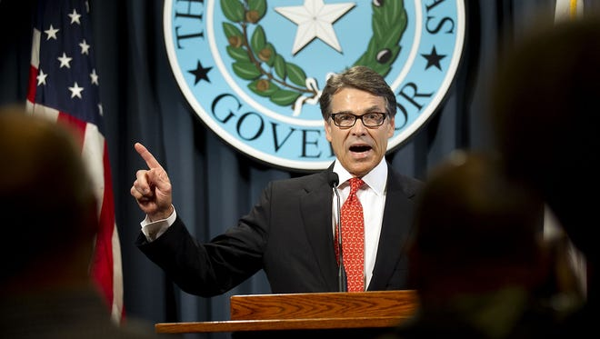 Gov. Rick Perry makes a statement in Austin, Texas on Saturday concerning the indictment on charges of coercion of a public servant and abuse of his official capacity. Perry is the first Texas governor since 1917 to be indicted. (AP Photo/Austin American-Statesman, Laura Skelding)