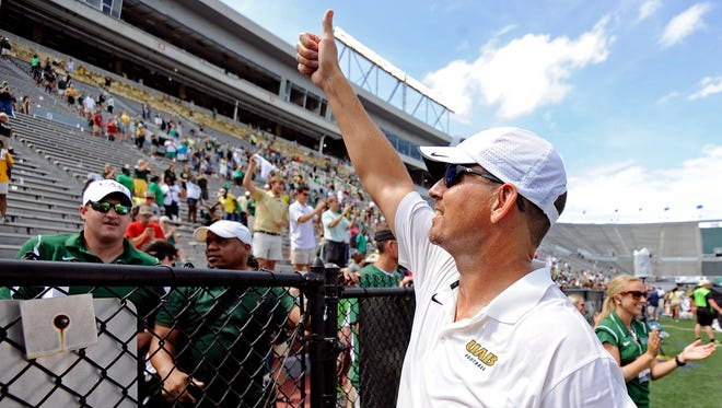 UAB head coach Bill Clark gives a thumbs up to fans after an NCAA college football against Troy in Birmingham, Ala., Saturday, Aug. 30, 2014. UAB won 48-10. (AP Photo/The (Troy) Messenger, Thomas Graning)