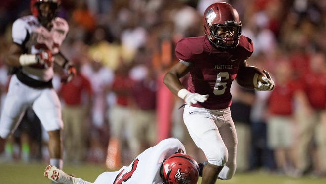 Prattville wide receiver James Davis (6) is tripped up by Central Phenix City defensive back Bernnardo Hinton (3) during the game between Central Phenix City and Prattville on Friday, Sept. 19, 2014, in Prattville, Ala.