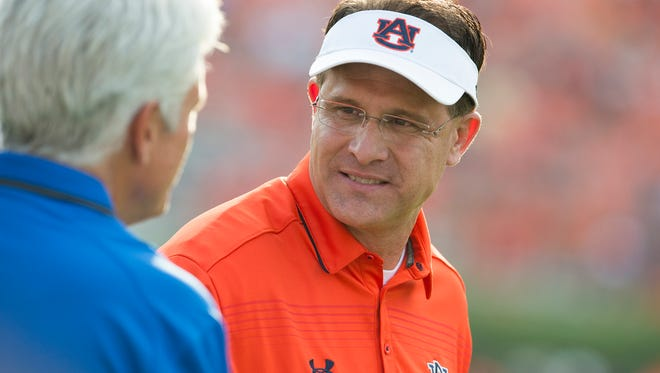 Auburn Head Coach Gus Malzahn speaks to a San Jose State coach before the NCAA football game between Auburn and San Jose State on Saturday, Sept. 6, 2014, at Jordan-Hare Stadium in Auburn, Ala.