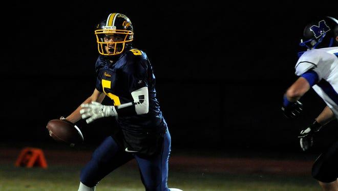 Highland quarterback Brandon Mack scrambles out against Millbrook on Friday in Highland.