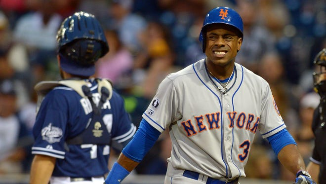 The Mets' Curtis Granderson, right, reacts after striking out in the eighth inning against San Diego at Petco Park on Saturday.