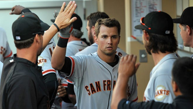Jul 5, 2014; San Diego, CA, USA; San Francisco Giants shortstop Joe Panik (center) is congratulated after hitting a RBI sacrifice fly in the seventh inning against the San Diego Padres at Petco Park. Mandatory Credit: Jake Roth-USA TODAY Sports