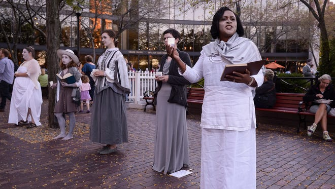 Mayor Lovely Warren performs poetry with Spoon River Rochester on Gibbs Street during the Rochester Fringe Festival on Friday.